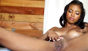 Black Beautiful female satisfying herself
